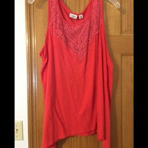 Coral tank top with design on the front.